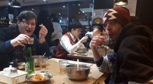 Drinking shots of soju