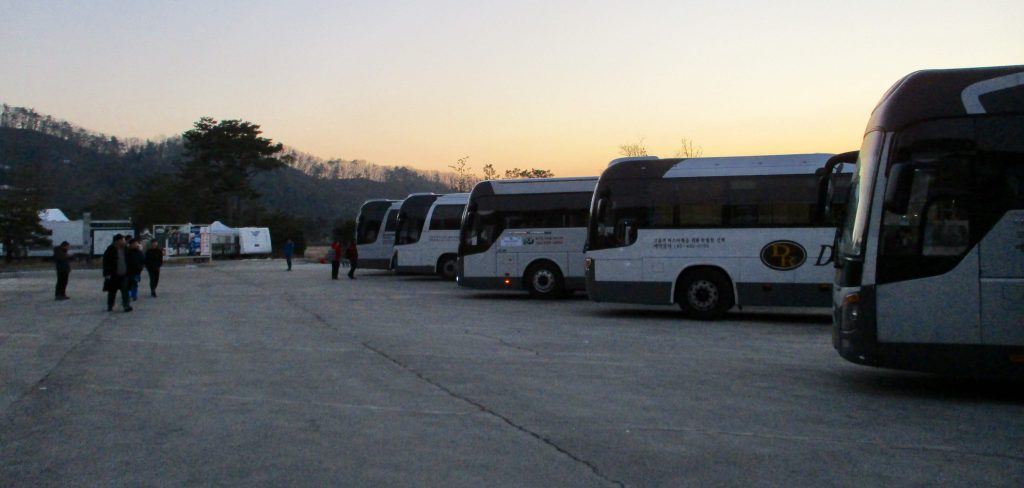 Shuttle buses waiting at Oak Valley